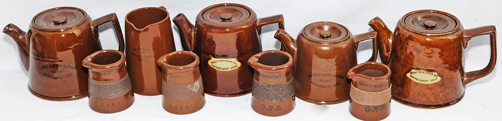 A Nice Collection Of Brown Earthenware Items
