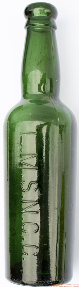 LMS NCC Hotels Green Beer Bottle, Stands 9 Inches