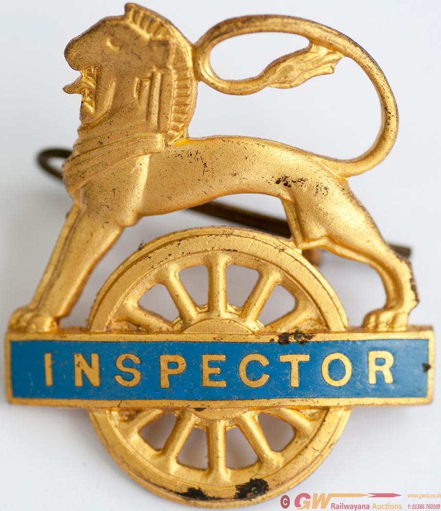 BR(Sc) Gilt Brass Lion Over Wheel Cap Badge
