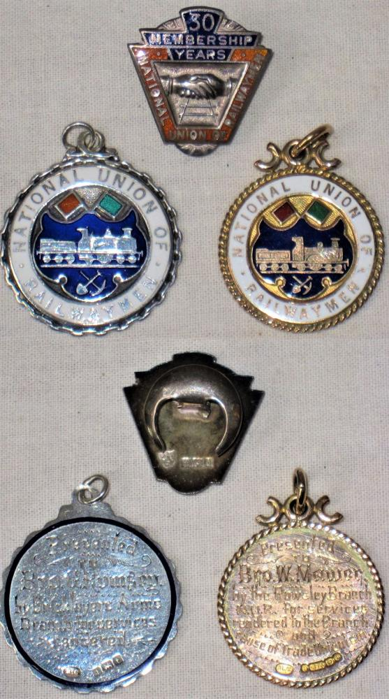 A Lot Containing N.U.R Sterling Silver 30 Years