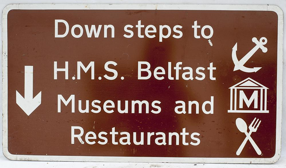 Road Sign. DOWN STEPS TO HMS BELFAST MUSEUMS AND