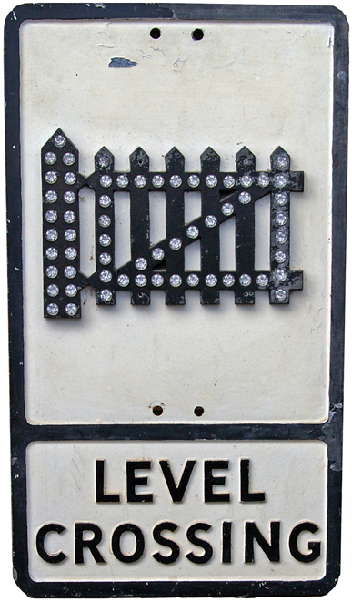 Road Sign, 'Level Crossing'. Shows The Classic