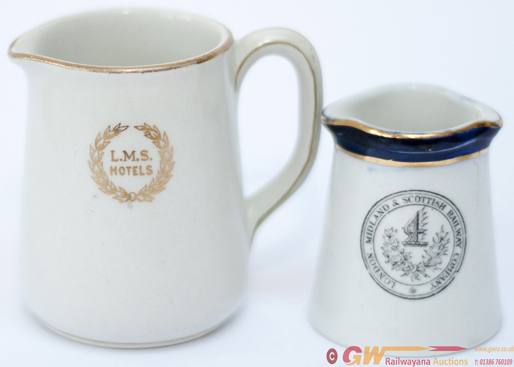 A Pair Of LMS Cream Jugs: One With Full Company