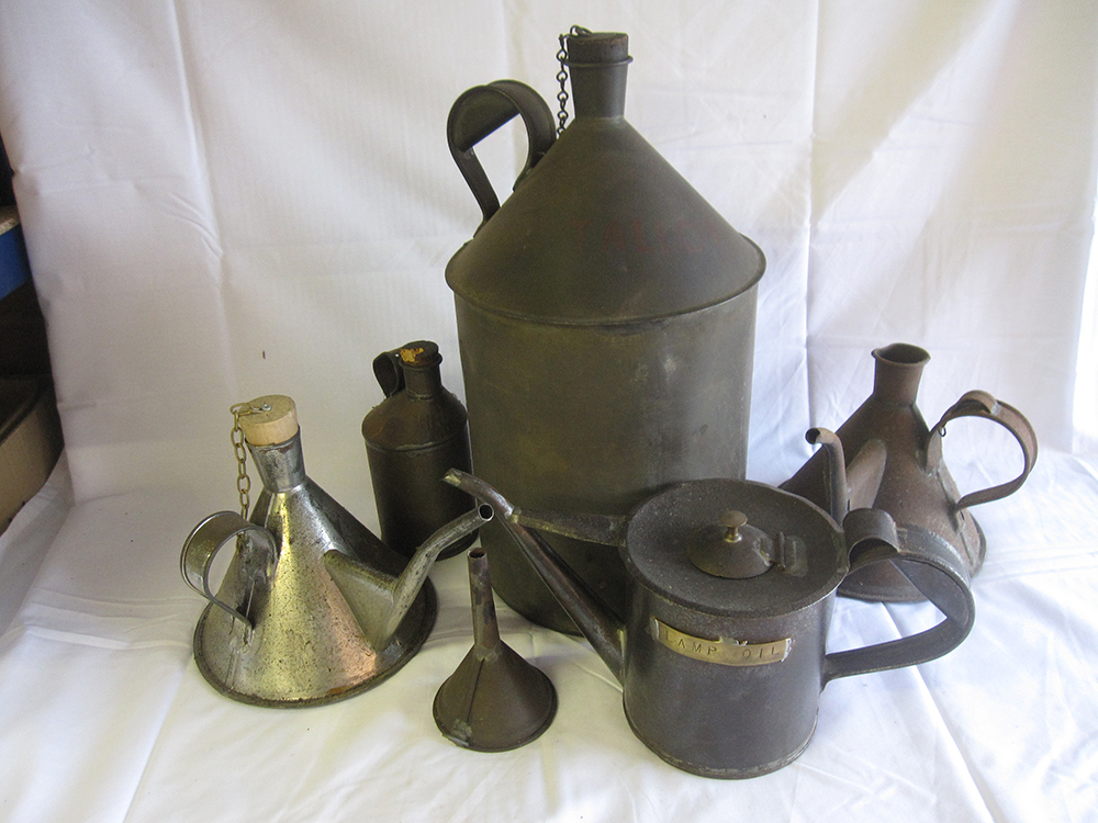 A Lot Containing Various Oil Cans And Measures