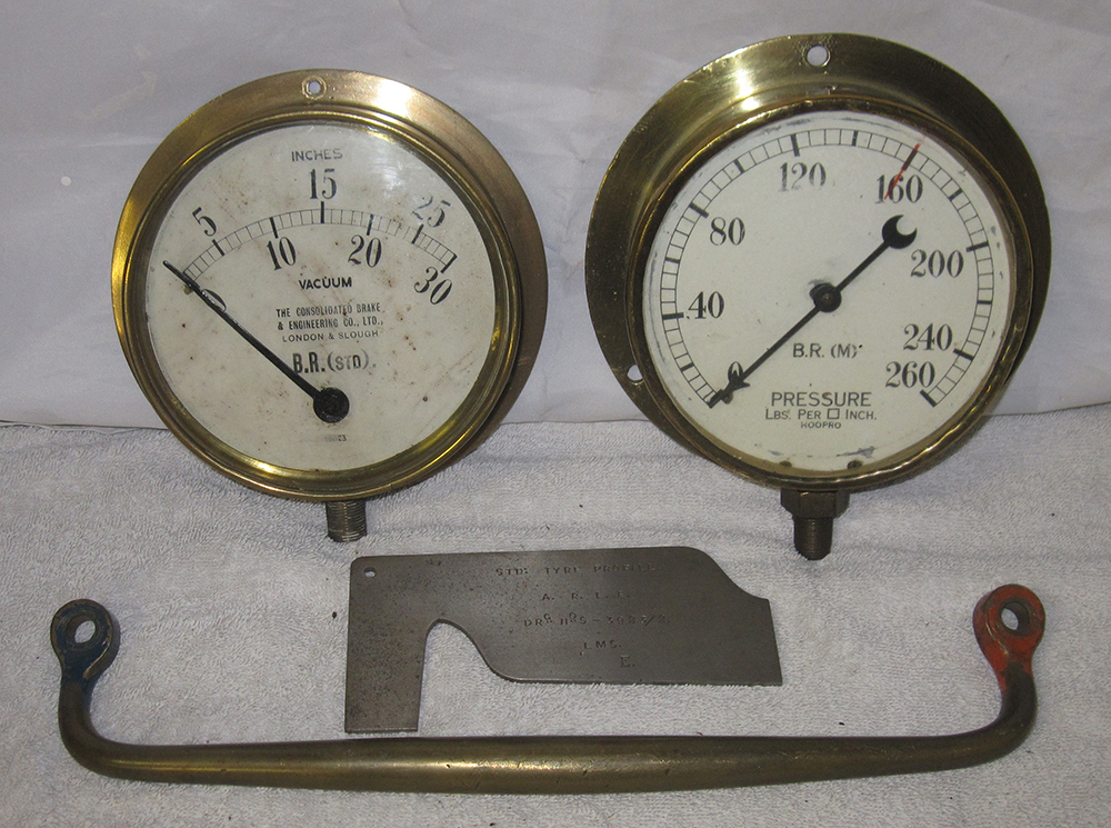 A Lot Containing Two Brass Pressure Gauges. BR(M)