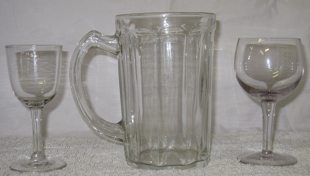 A Lot Containing 3 X Items Of LMS Glassware. LMS