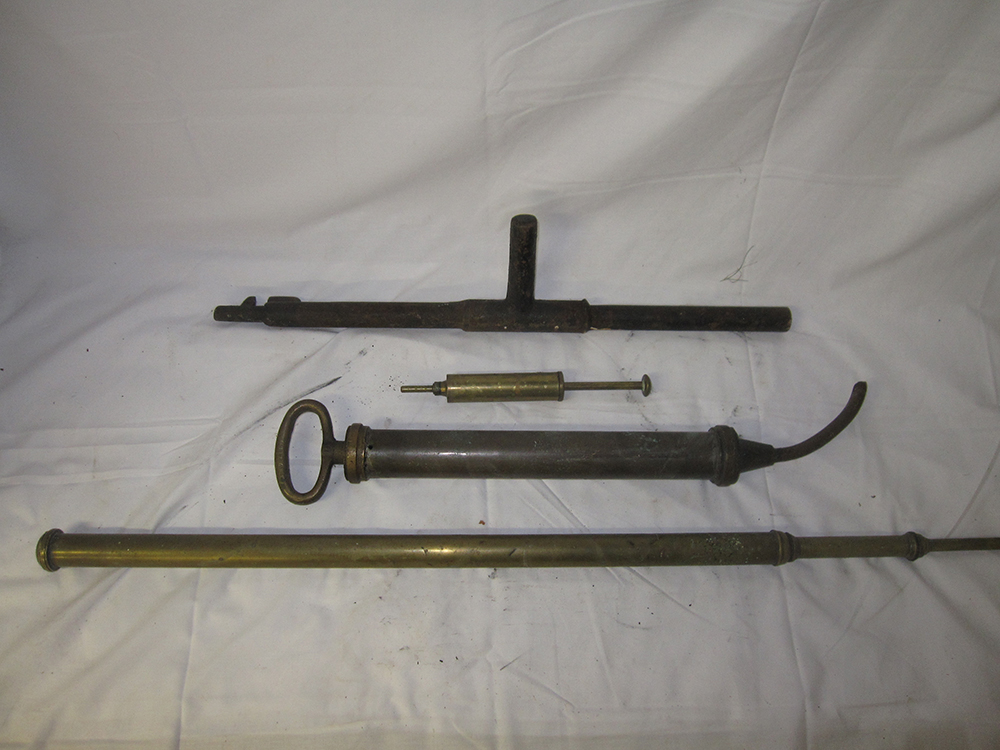 A Lot Containing A Small Brass Syringe, Large