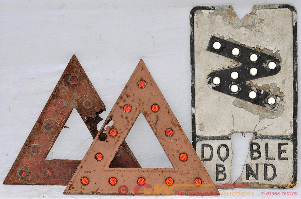 A Lot Containing 2 X Damaged Road Sign Triangle
