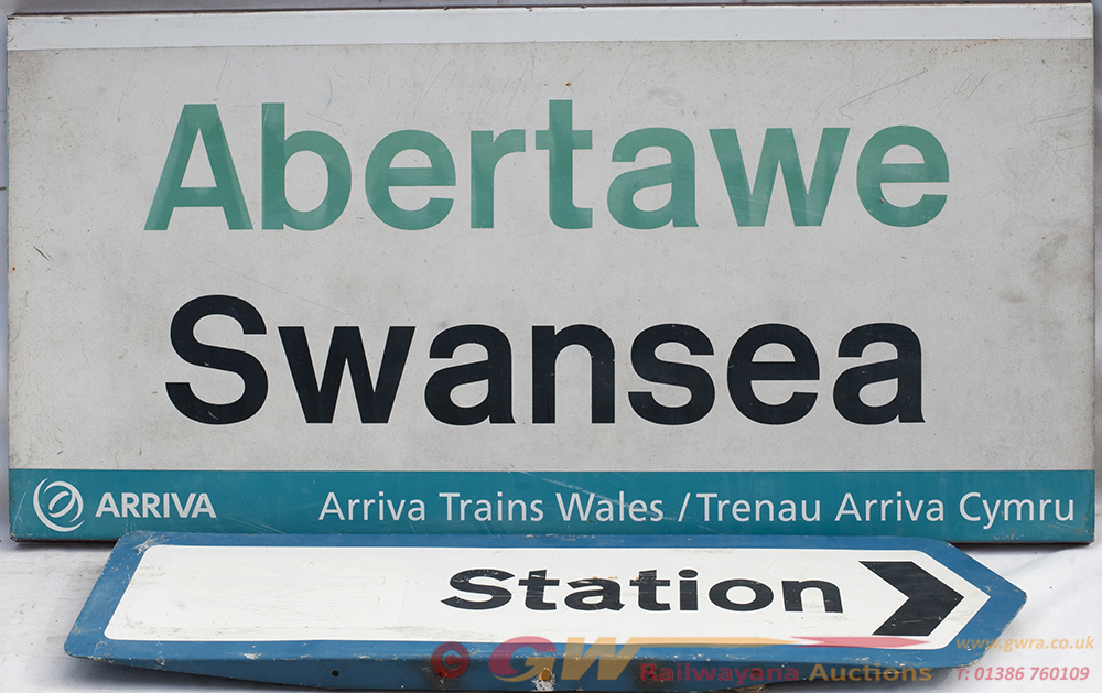 BR Station Direction Sign And An ARRIVA SWANSEA