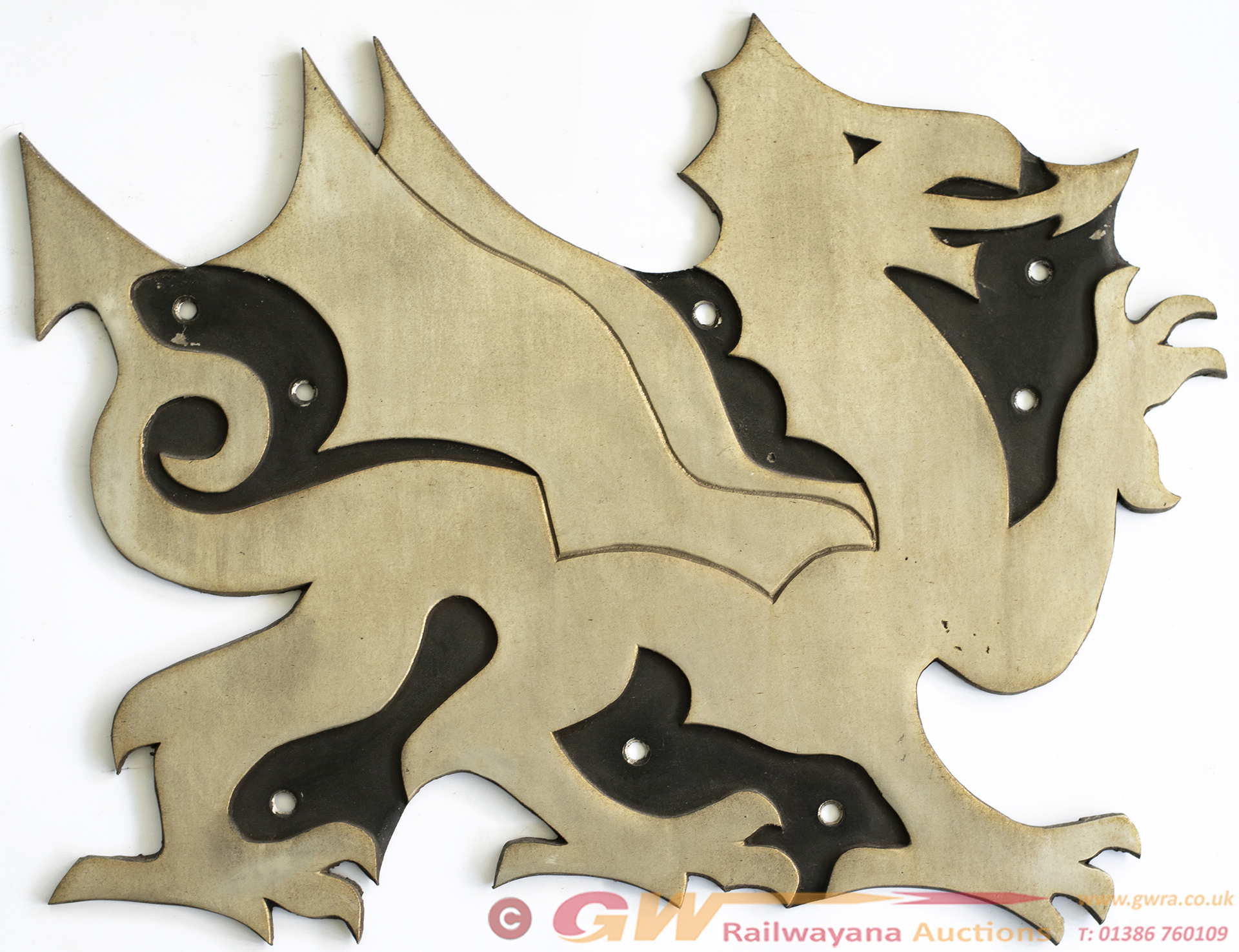Fragonset Cast Aluminium Wyvern Logo Carried By